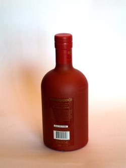 A photo of the back side of a bottle of Bruichladdich Redder Still 1984