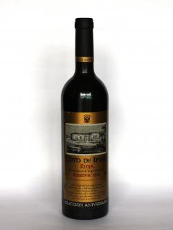 A photo of the frontal side of a bottle of Coto de Imaz Reserva 1998