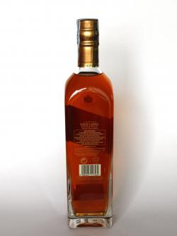 A photo of the back side of a bottle of Johnnie Walker Gold Label Reserve Blended Scotch Whisky
