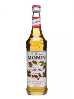A bottle of Monin Hazelnut Syrup