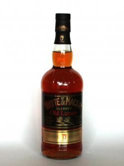 A photo of the frontal side of a bottle of Whyte & Mackay 19 year Luxury
